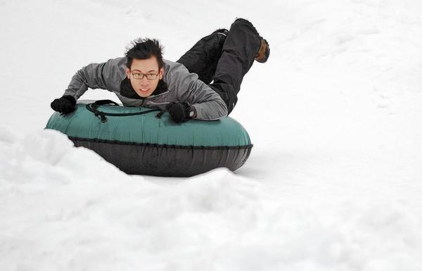 Vince Arcangel of Allentown slides down the hill on a snow tube at Bear Creek Mountain Resort.