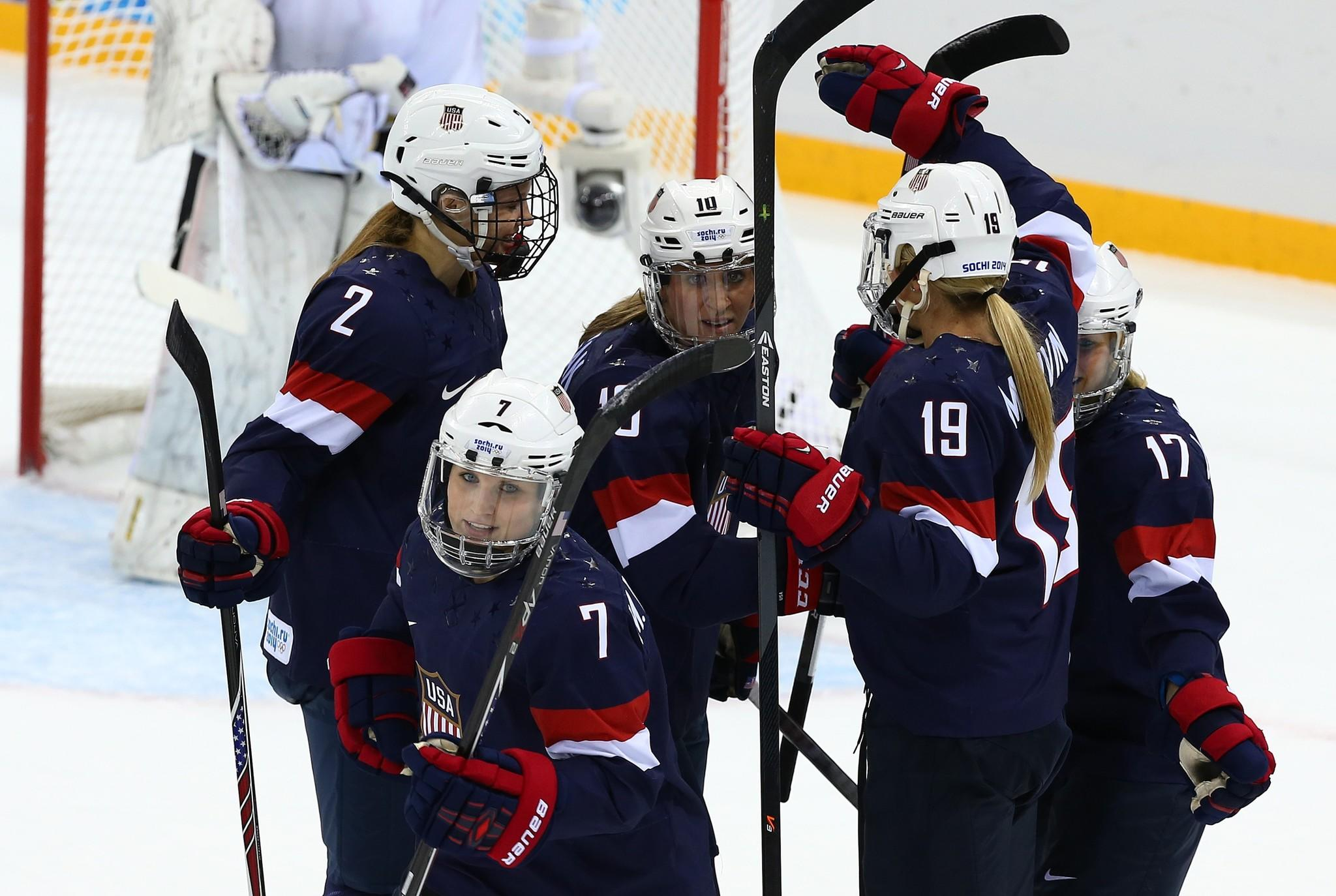 Monique Lamoureux (7) of United States celebrates with teammates after scoring her team's sixth goal in the second period during the Women's Ice Hockey Preliminary Round Group A game against Switzerland.