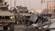 Suicide bomber hits NATO convoy in Afghanistan; 2 contractors killed