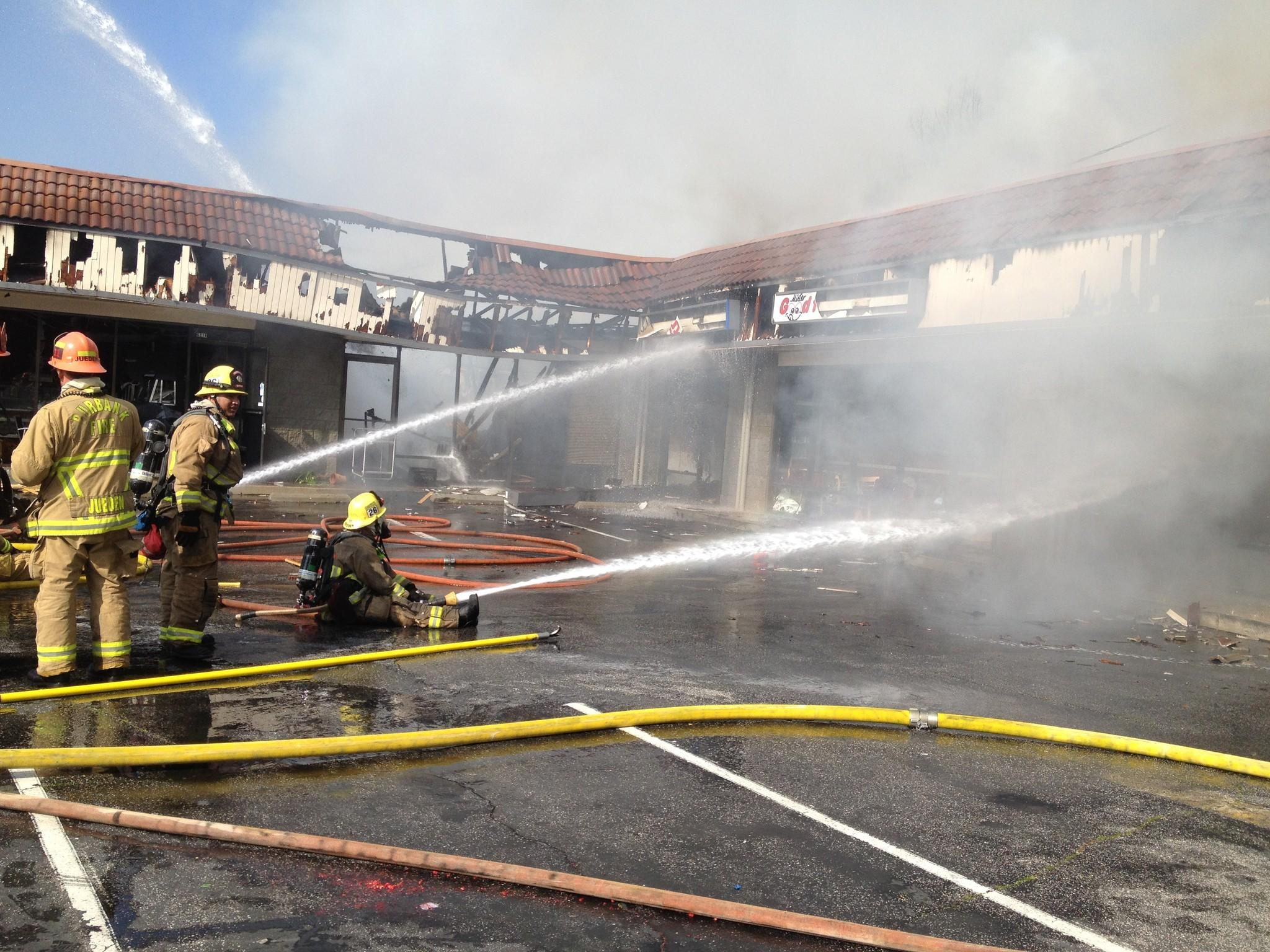 Firefighters hose down a blaze that broke out in a strip mall on Glenoaks Boulevard Monday, Feb. 10, 2014.