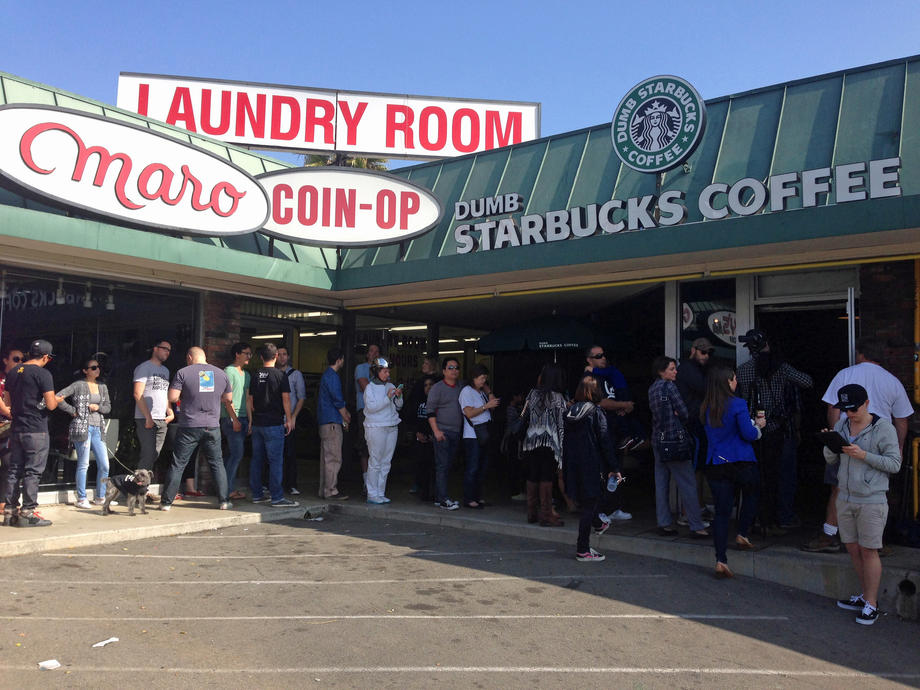 People wait outside the Dumb Starbucks shop at Hillhurst Avenue and Melbourne Avenue in Los Feliz.