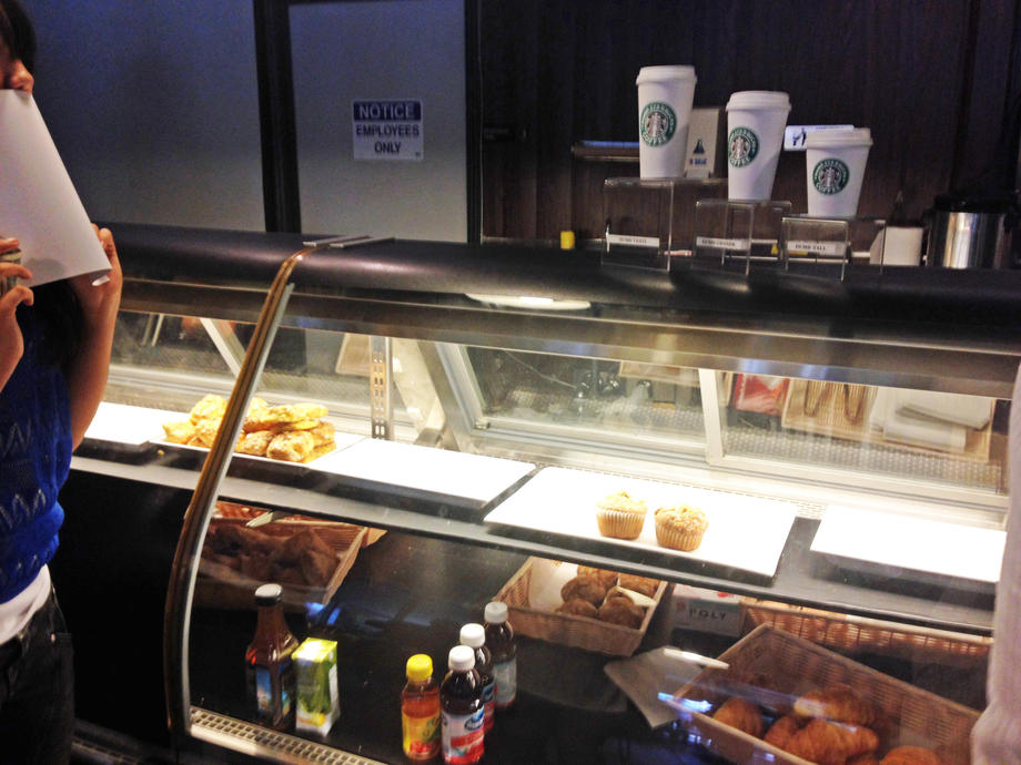 Pastries, purchased at a nearby Vons, are displayed in a case at Dumb Starbucks.