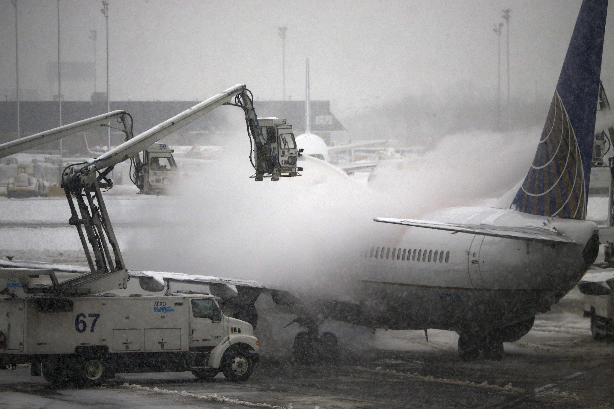 A United Airlines jet is de-iced before taking off from Newark Liberty International Airport in Newark, New Jersey.