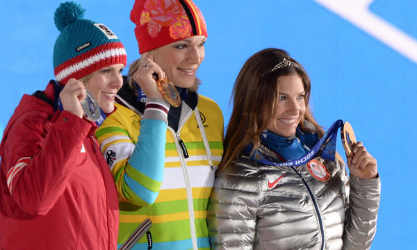 Austria's silver medalist Nicole Hosp, left, Germany's gold medalist Maria Hoefl-Riesch, center, and American bronze medalist Julia Mancuso show off their super-combined medals following a podium ceremony at the 2014 Sochi Winter Olympic Games.
