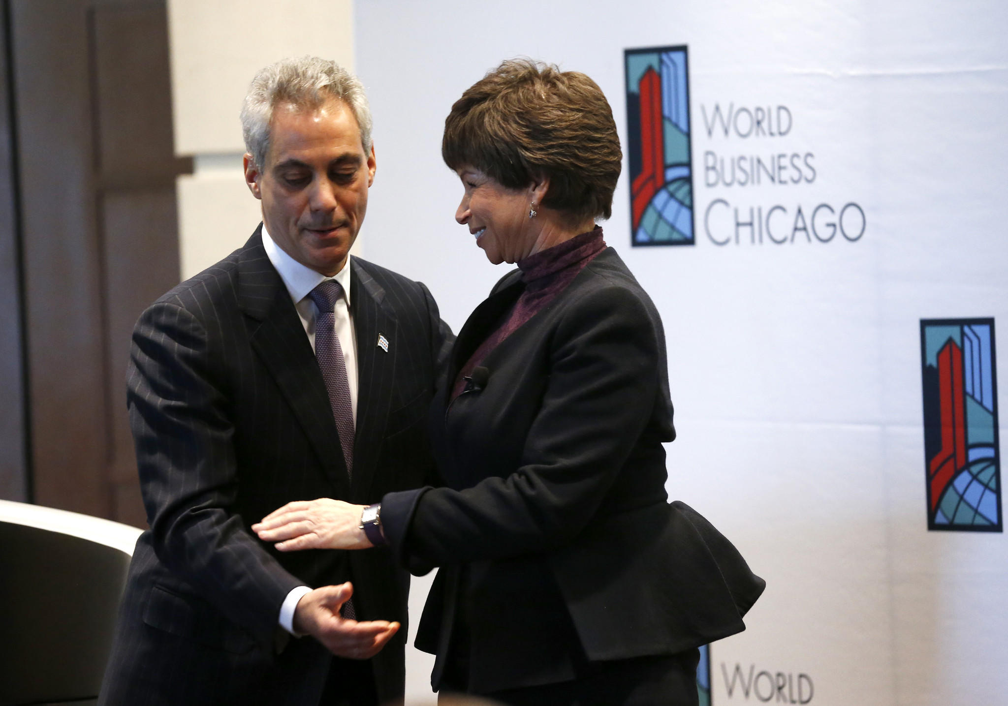Mayor Rahm Emanuel gives a hug to White House Senior Advisor Valerie Jarrett.