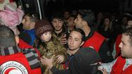 Syria and rebels agree to extend rescue effort in city of Homs
