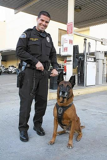 Huntington Beach Police Officer Casey Thomas with Bodhy.