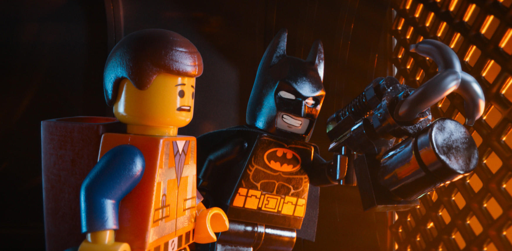 "Characters Emmet, voiced by Chris Pratt, left, and Batman, voiced by Will Arnett, in a scene from ""The Lego Movie."""