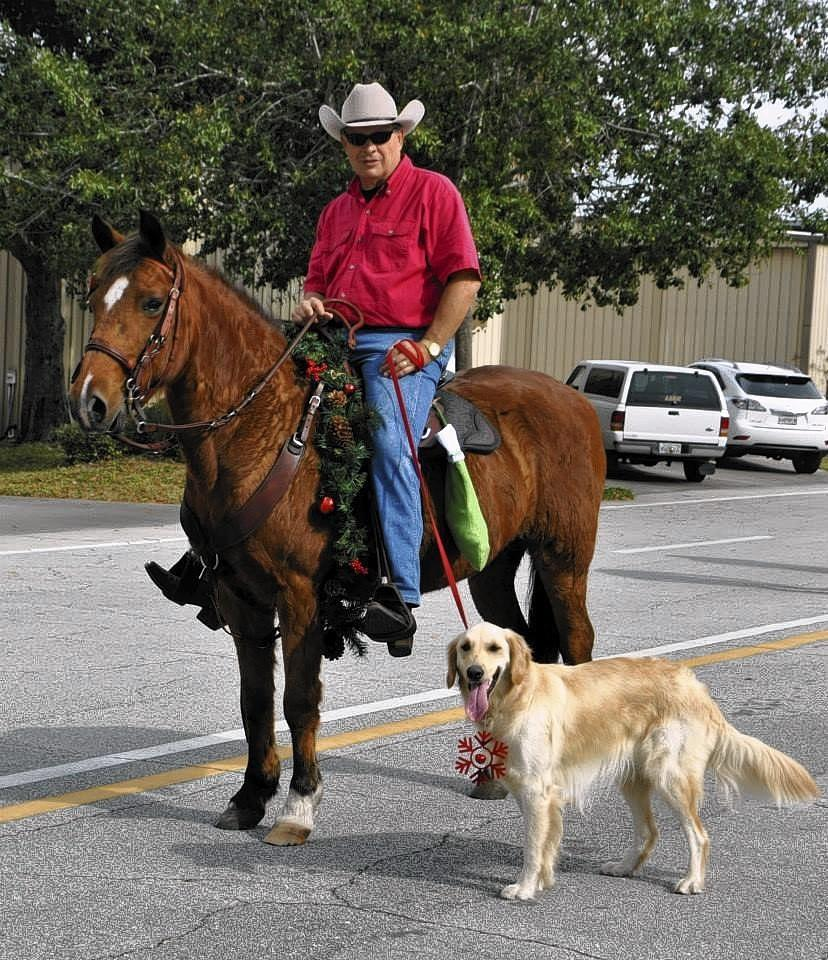 Dumpling the golden retriever was in a parade along with her owner, Wayne Dreier, and his horse, Reba, before Christmas 2013 at Spruce Creek Fly-In near Port Orange. The dog was discovered missing Feb. 5, 2013.