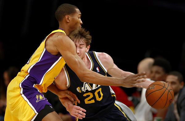 Lakers forward Wesley Johnson tries to cut off a drive by Utah Jazz forward Gordon Hayward during a Lakers victory at Staples Center on Jan. 3.