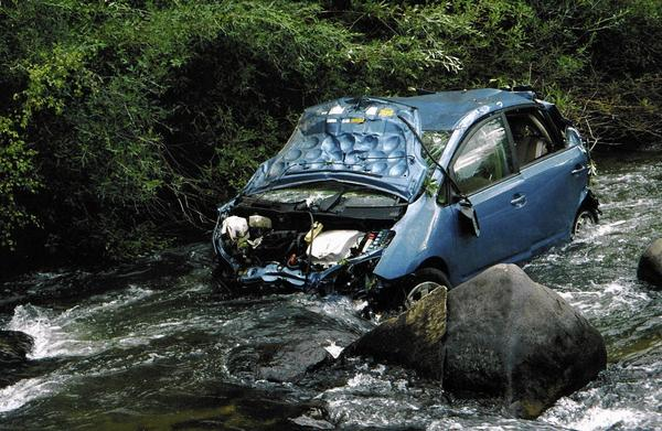 Toyota has settled a number of sudden-acceleration lawsuits out of court, including a $10-million deal reached in 2010. Above, the wreckage a 2005 Prius sits in a Colorado creek, where it came to a halt after reportedly suddenly accelerating to 90 mph on a mountain highway.