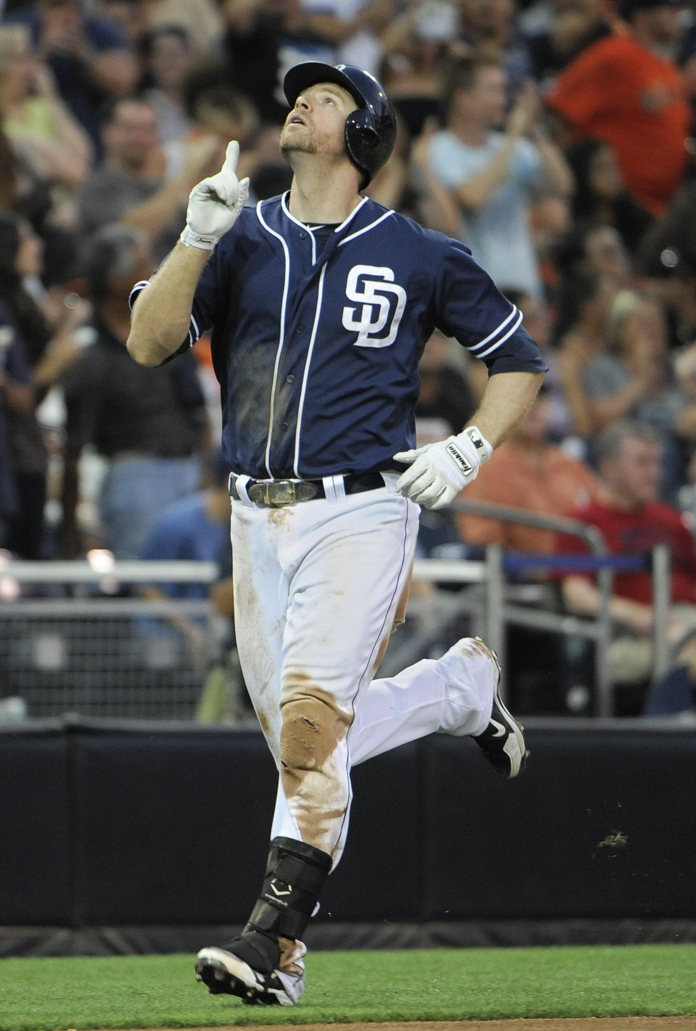 Padres slugger Chase Headley points skyward after hitting a two-run homer in a game against the Giants.