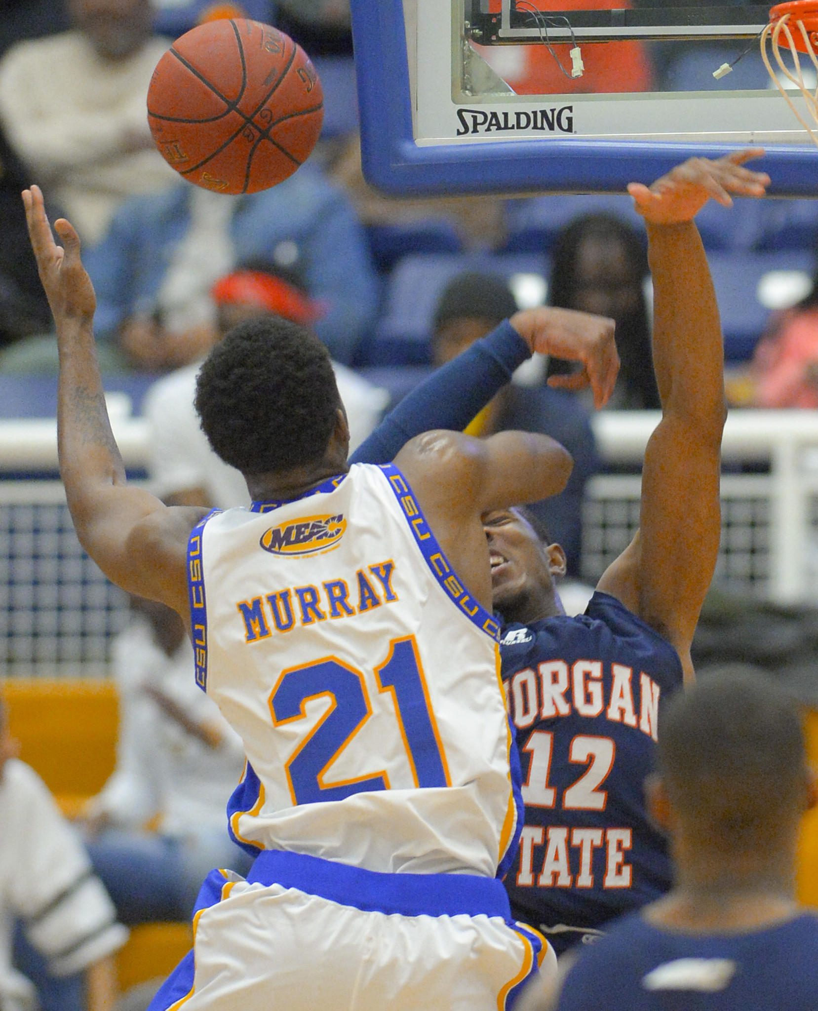 Morgan State forward Thair Heath is injured on this foul by Coppin State forward Michael Murray during the first half on Monday.