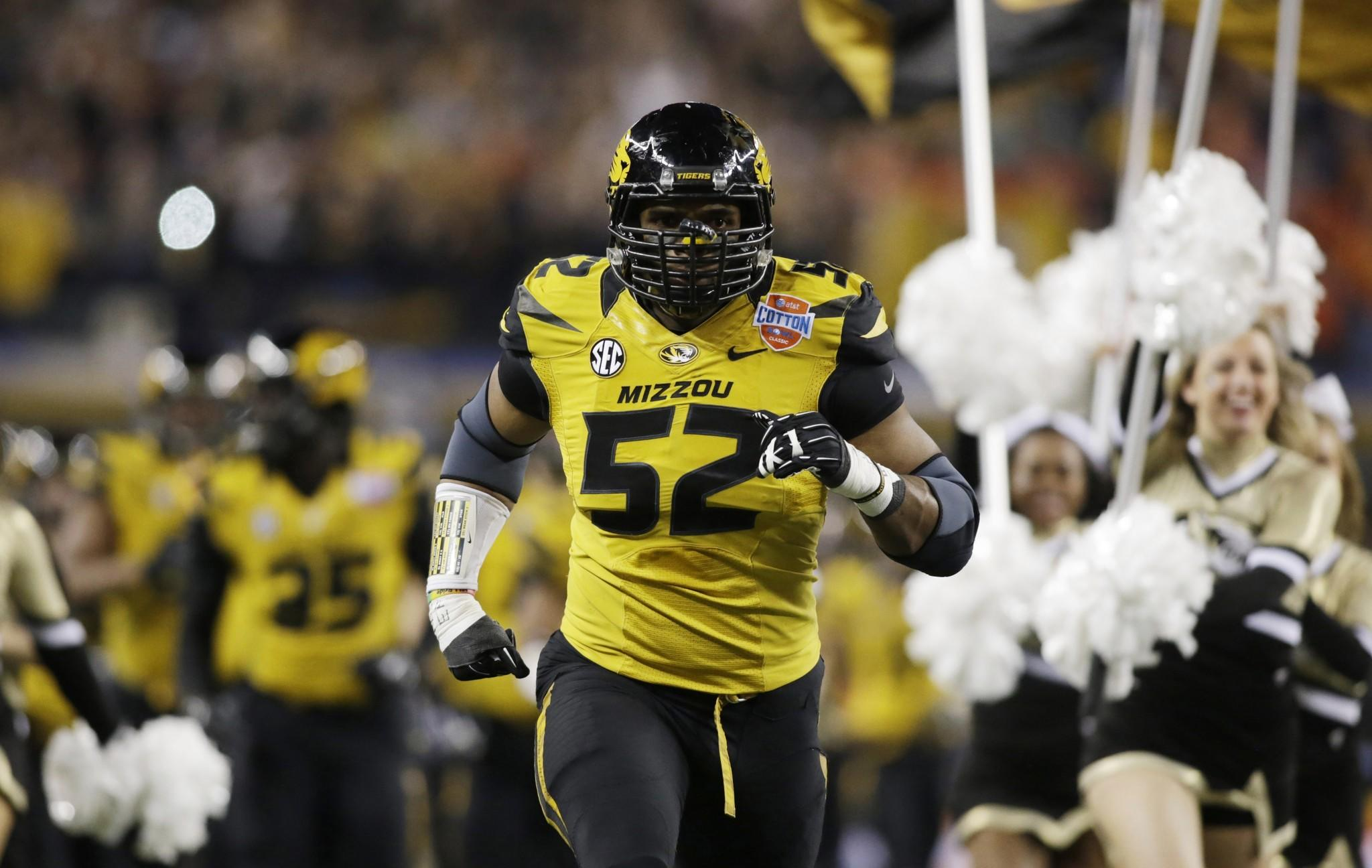 Missouri defensive lineman Michael Sam runs on the field before playing Oklahoma State in January.