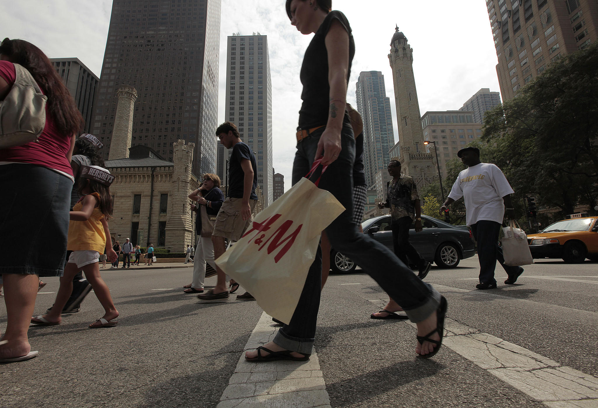 Pedestrians and shoppers near Water Tower Place on North Michigan Avenue in Chicago on Aug. 17, 2011.