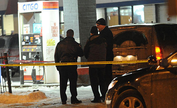 Chicago police on the scene of a fatal shooting in the 700 block of east 103rd where three men tried to rob an off duty Cook County Sheriff in a Citgo gas station.
