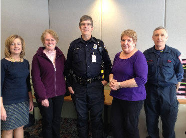 Enfield Senior Center director Susan Lather, Yoke Twarosch, Officer Philip Thomas, Marlene Hoginski and firefighter Don Ellis are all part of the revival of the TRIAD program that partners senior citizens with public safety officials.