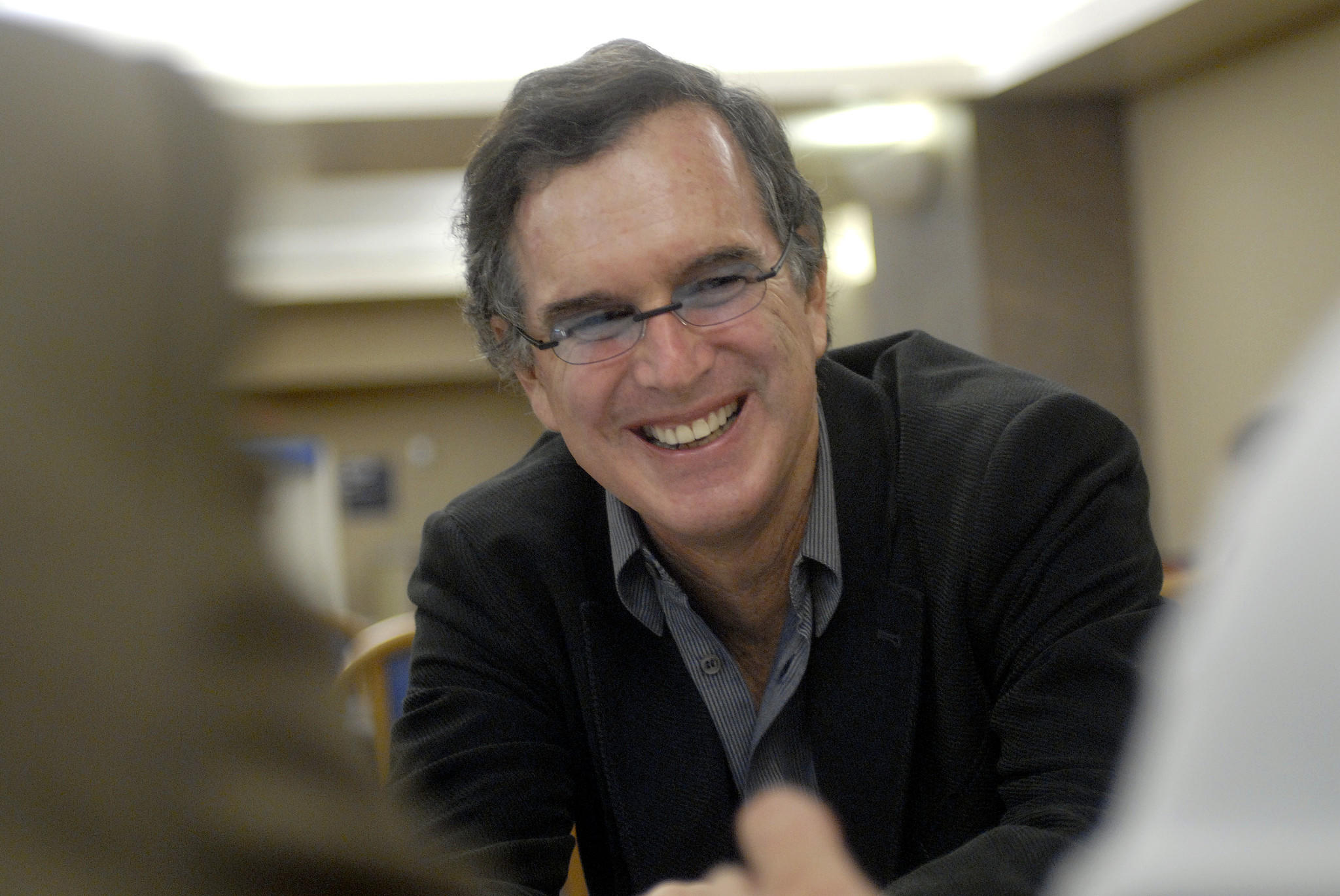 "At the Department of Veterans Affairs, Garry Trudeau signs copies of his book ""The Sandbox."""