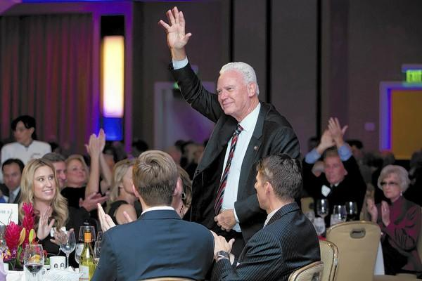 Newport Beach Mayor Rush Hill waves to those in attendance at the 33rd annual Mayor's Dinner, hosted Friday by Speak Up Newport at the Newport Beach Marriott Hotel and Spa.