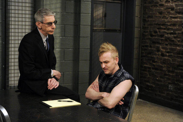 "Robin Lord Taylor (seated) appears in an episode of ""Law & Order: SVU"" with Richard Belzer."