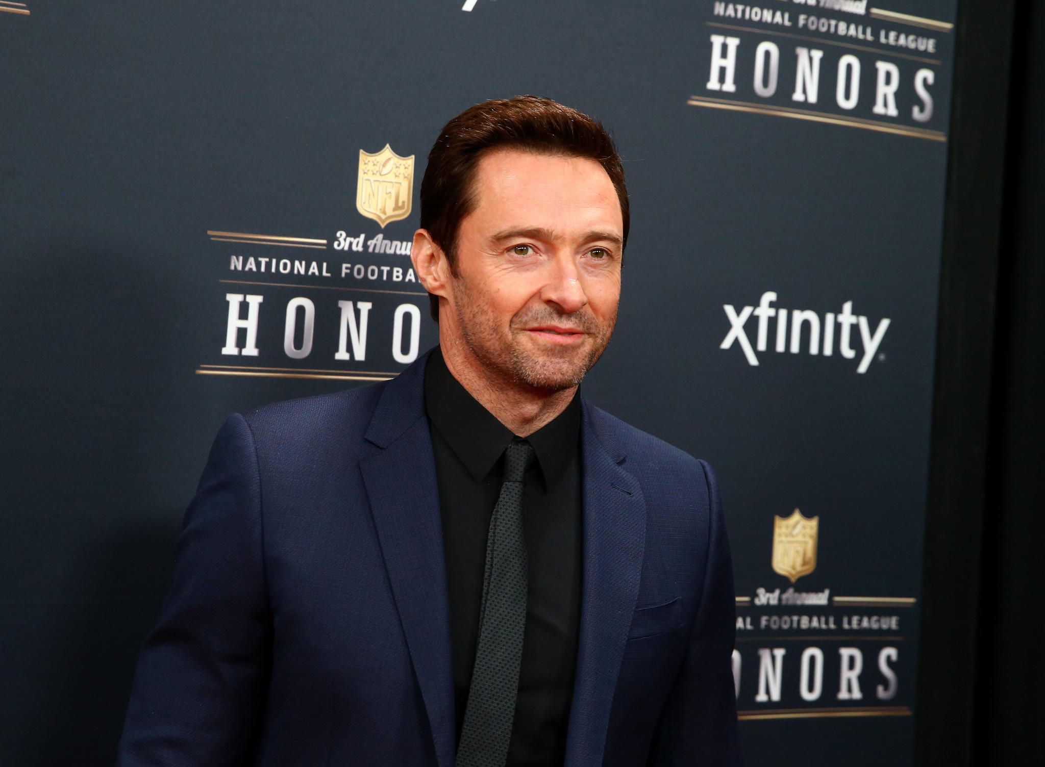 Hugh Jackman walks the red carpet prior to the NFL Honors at Radio City Music Hall.