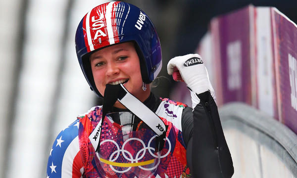 American Kate Hansen celebrates following her third luge run at the Sochi Winter Olympic Games on Tuesday. Hansen finished 10th, but the result didn't curb her enthusiasm for competing on the world's biggest stage.