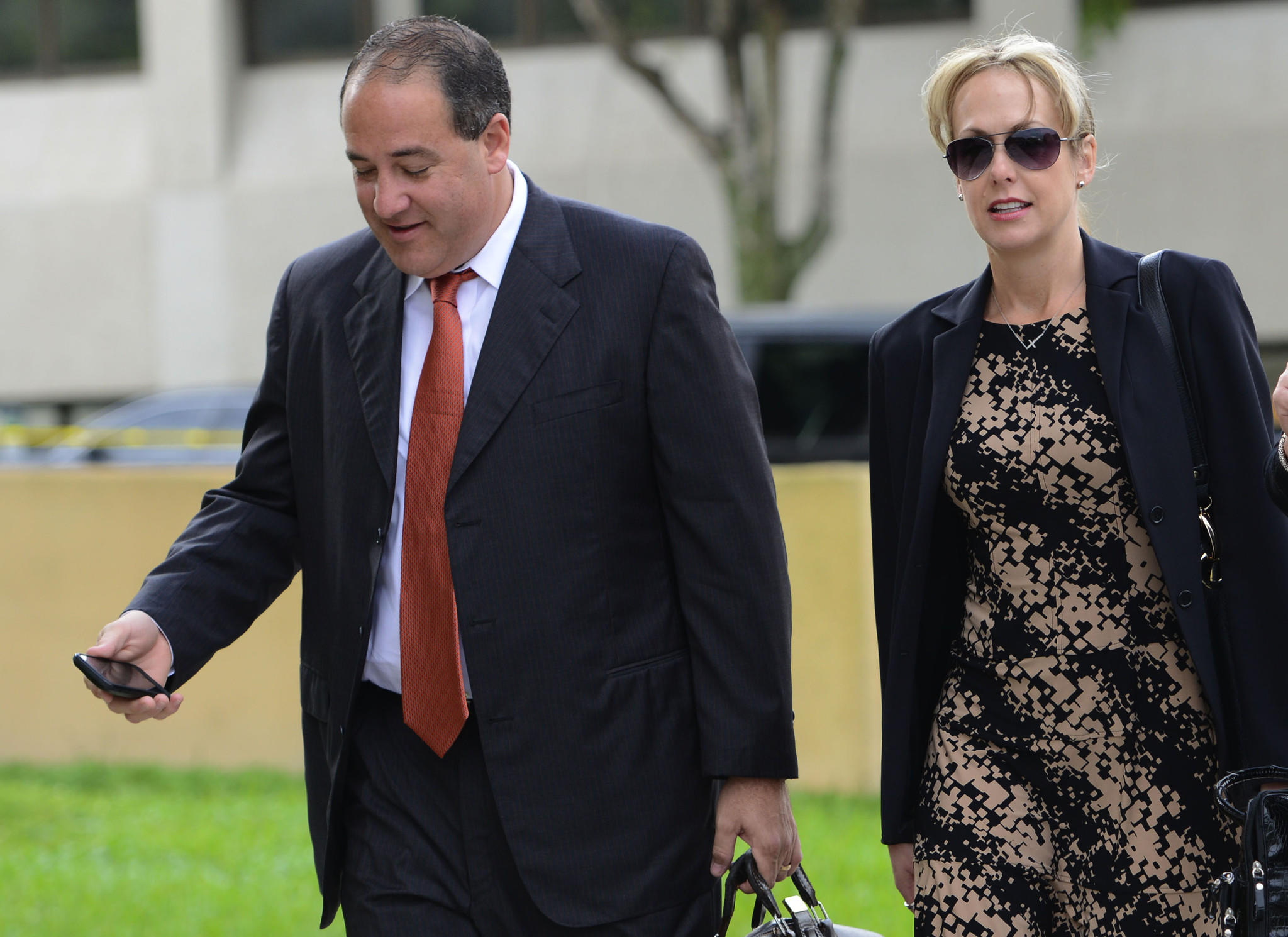 Christina Kitterman, an attorney who formerly worked for Scott Rothstein, arrives at the federal courthouse in West Palm Beach Thursday with her attorney Valentin Rodriguez Jr. for day four of her trial on wire fraud charges. Mark Randall, South Florida Sun Sentinel