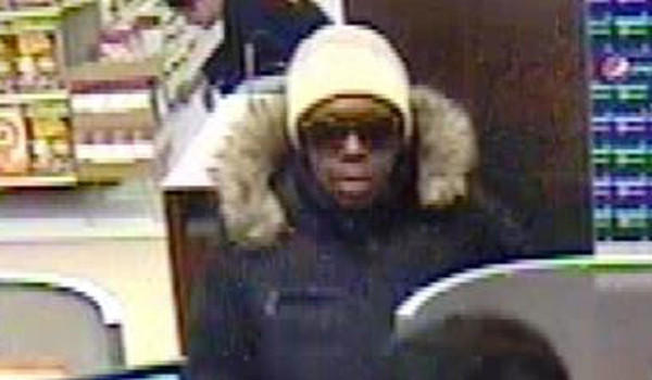 Surveillance photo of a woman who robbed a TCF Bank branch at 4355 N. Broadway on Tuesday. The woman is suspected of three other bank robberies last year.