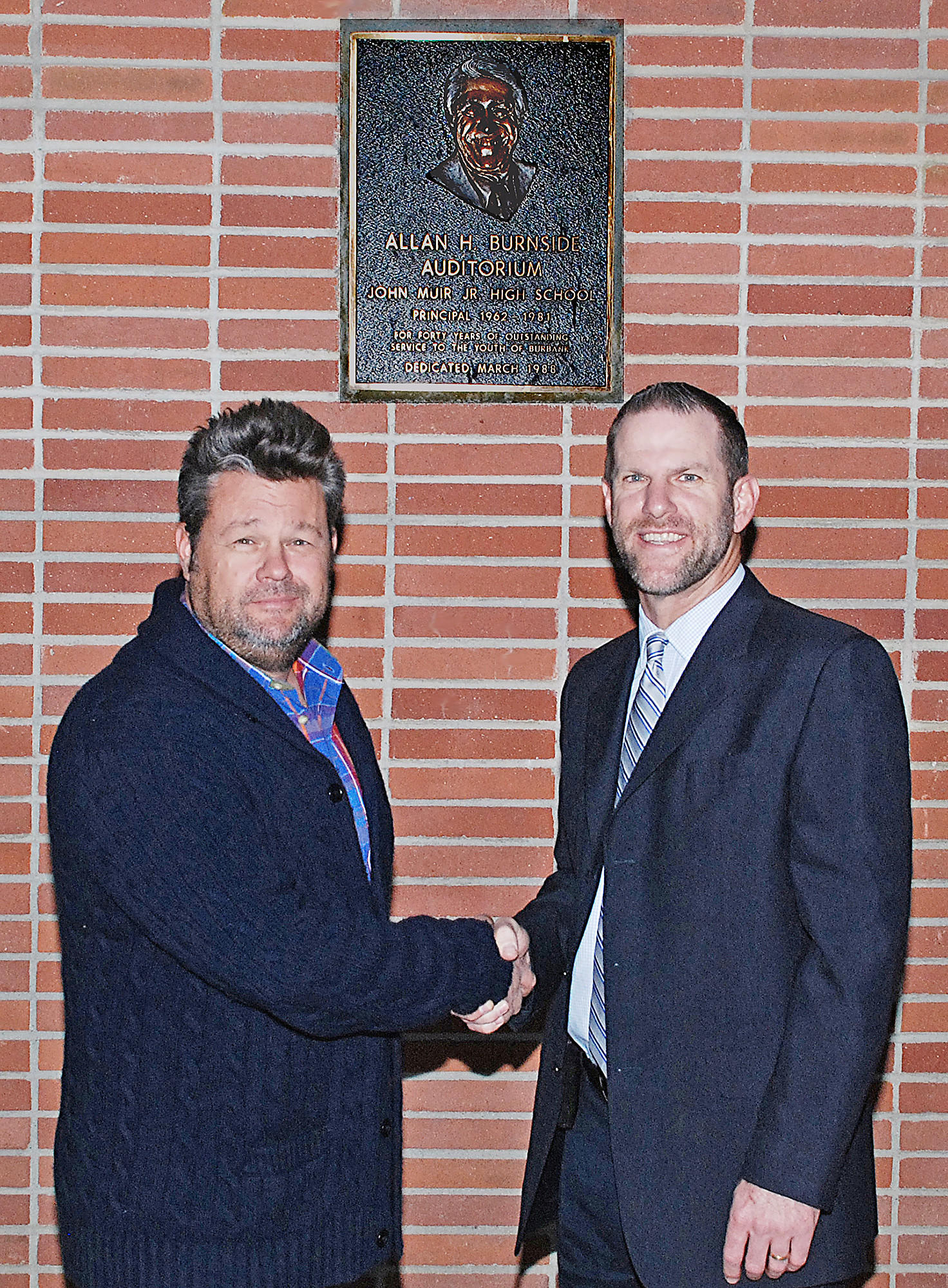 """Carson Smith, left, from Nickelodeon, and John Muir Middle School principal Greg Miller talk about """"The Really Big Show"""" benefit that will raise funds to upgrade the Allan H. Burnside Auditorium."""
