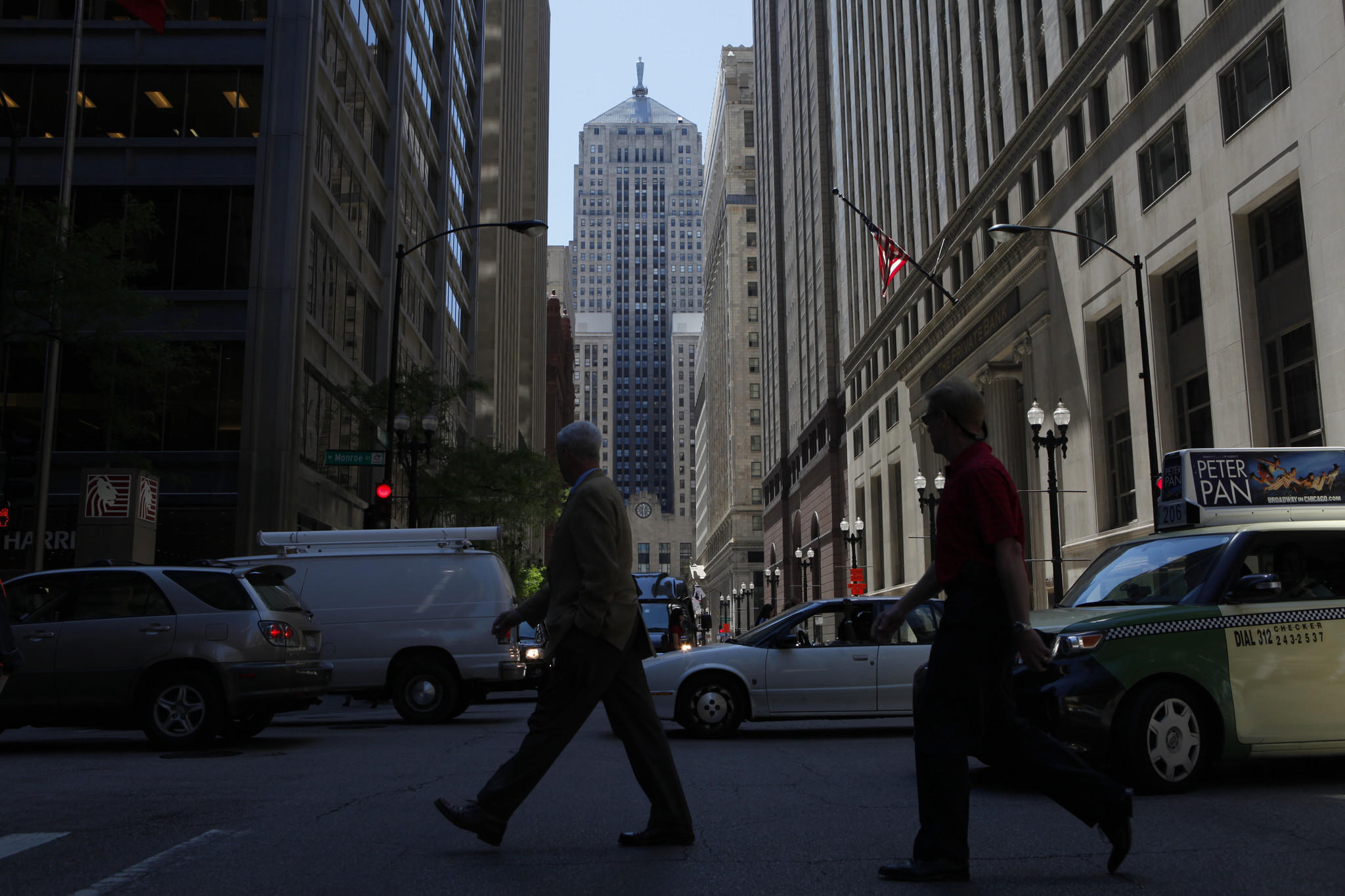 Pedestrians cross LaSalle Street in the shadow of the iconic Chicago Board of Trade Building.