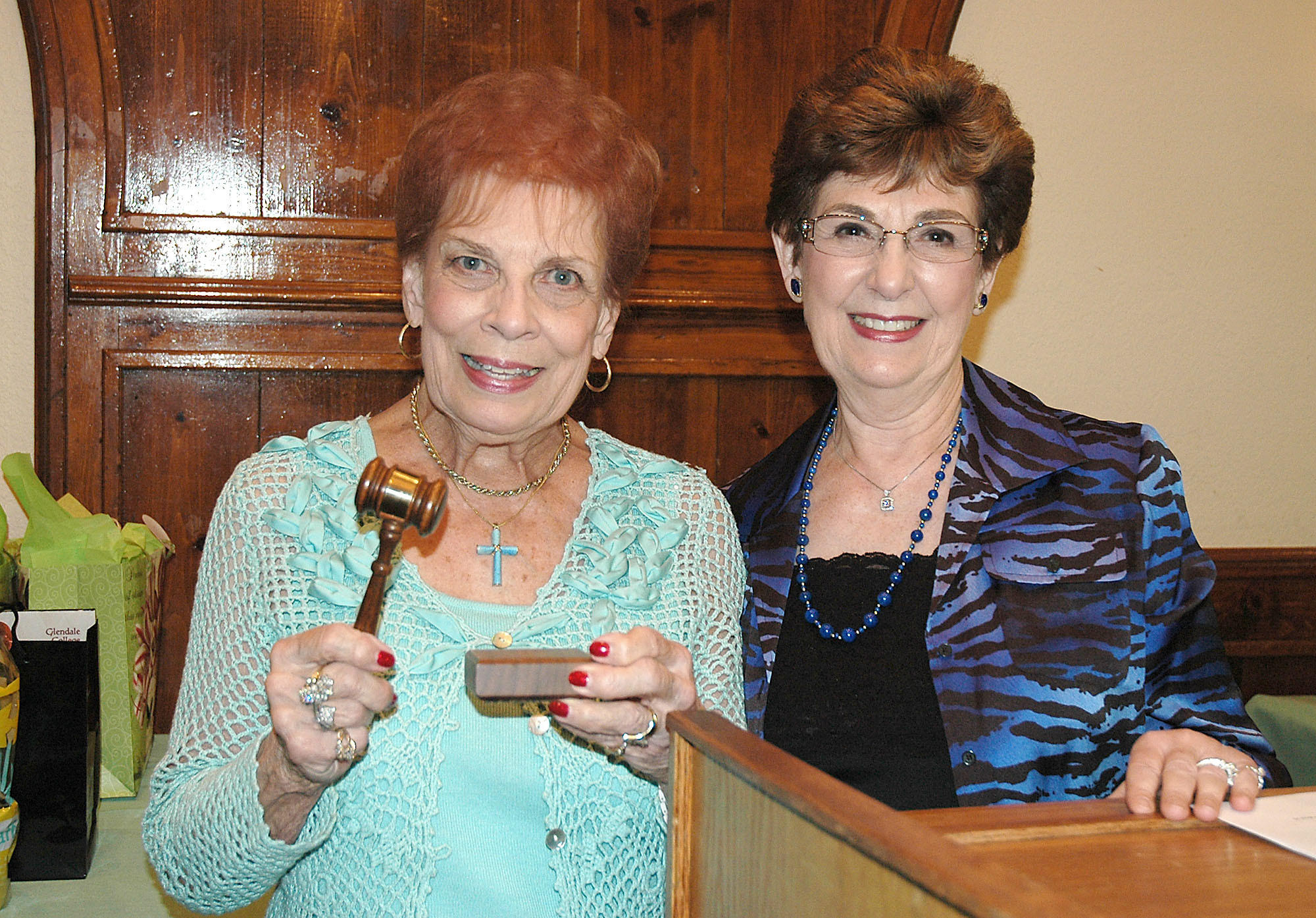 Betty Musacco, left, incoming president of the Patrons Club of Glendale Community College, receives the gavel from outgoing president Carolyn Payne at the Castaway Restaurant.