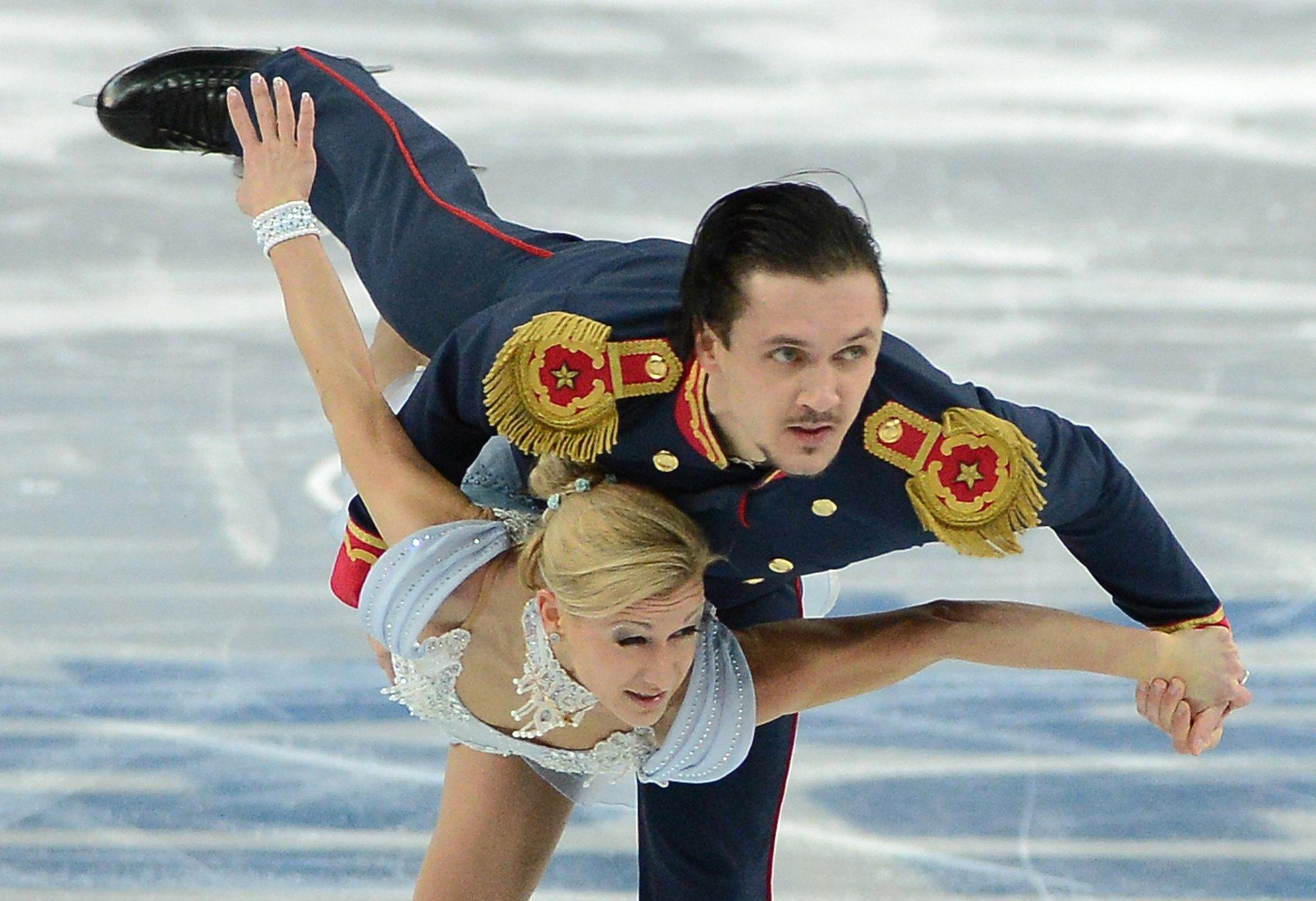Russia's Maxim Trankov and Tatiana Volosozhar perform during the pairs short program.