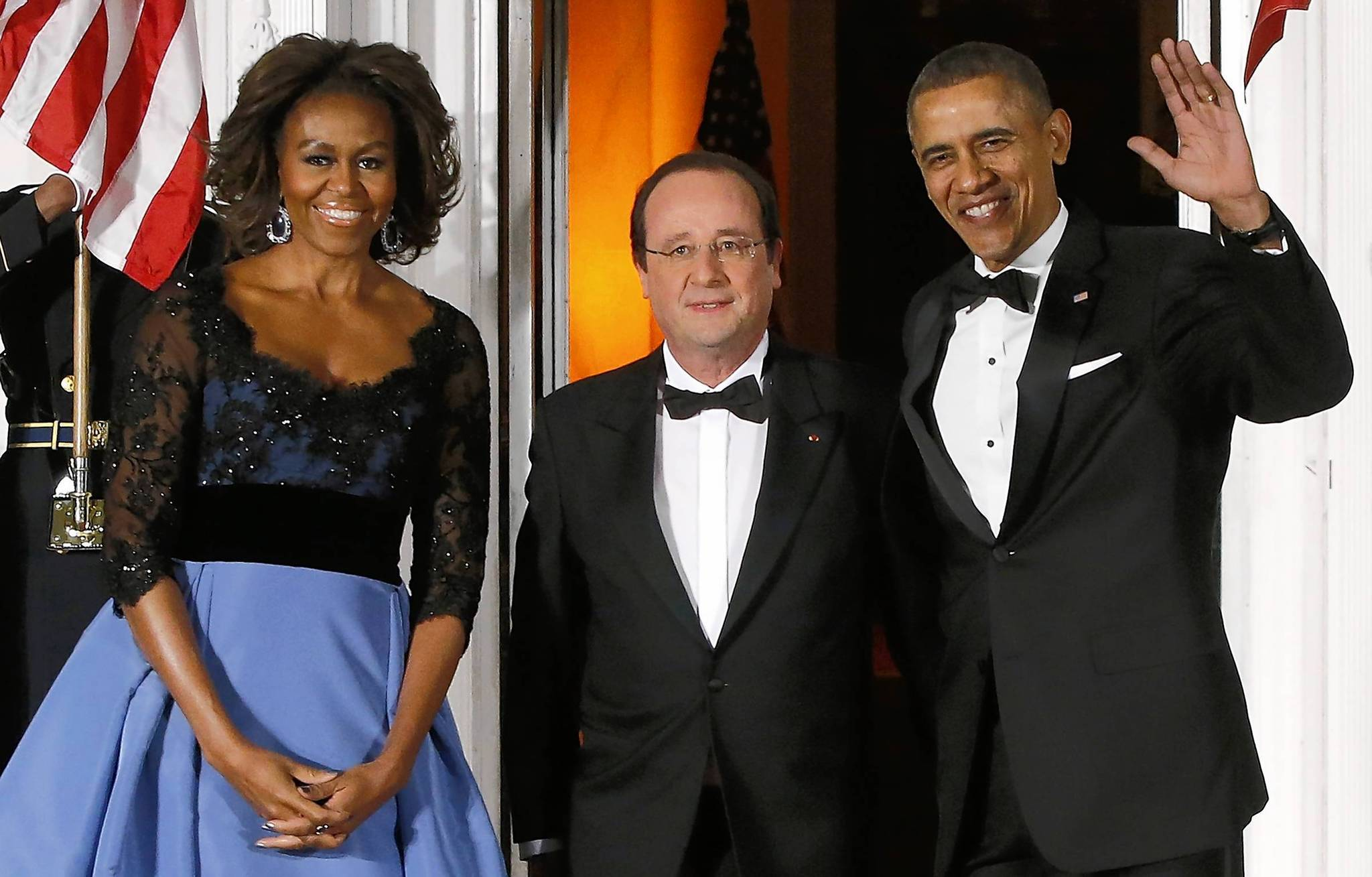 President Barack Obama and first lady Michelle Obama greet French President Francois Hollande as he arrives for a state dinner at the White House on Tuesday night.