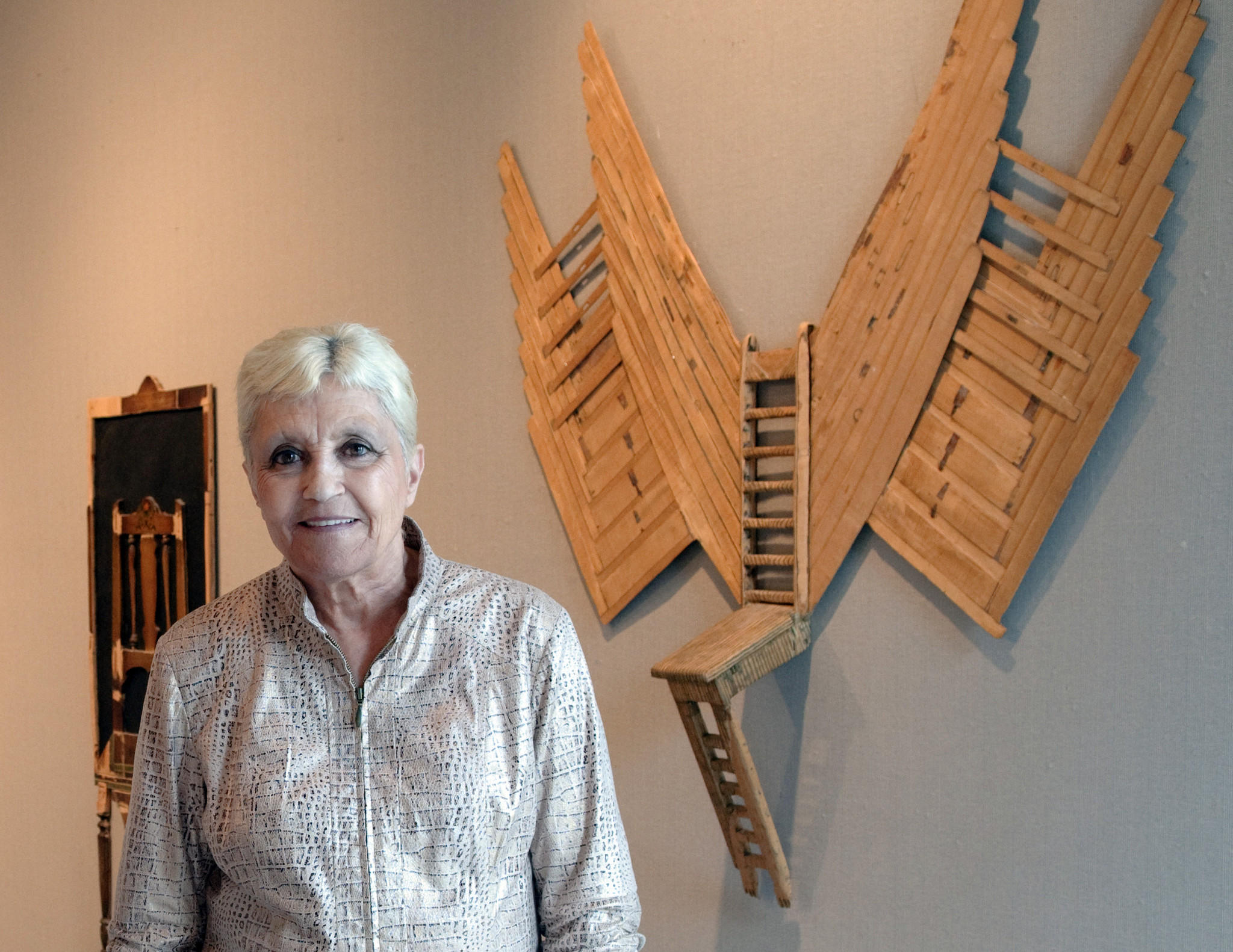 "Margaret Wharton with her art titled ""Mockingbird"" made for her son."