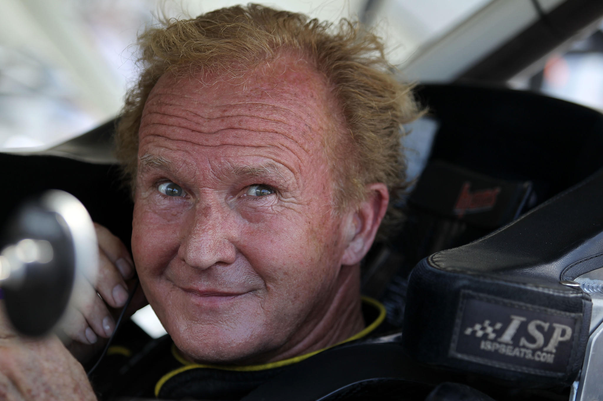 Morgan Shepherd, driver of the #89 Racing with Jesus Dodge, sits in his car during qualifying for the NASCAR Nationwide Series Subway Firecracker 250 at Daytona International Speedway.