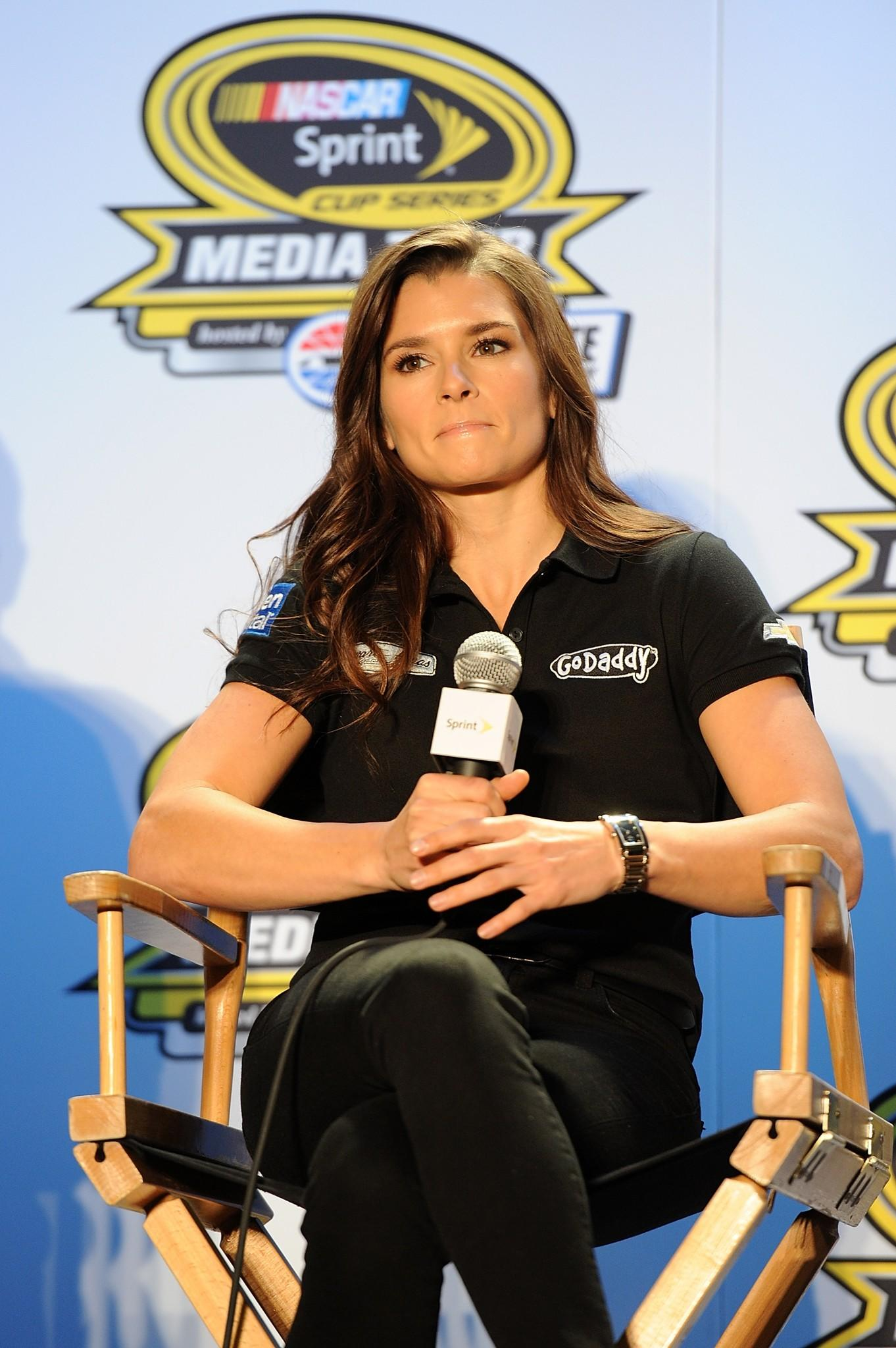 Danica Patrick, driver of the #10 GoDaddy.com Chevrolet, looks on during NASCAR Sprint Media Tour at Charlotte Convention Center.