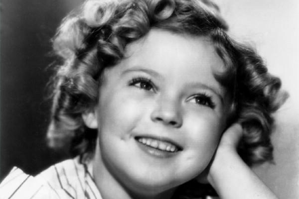 Shirley Temple Black, shown in 1935, shows of her signature curls and ...
