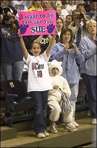 Fans Rebecca Kallas, 11, her brother, Stephen, 7, and mother, Patti, show their support for the undefeated Connecticut women's basketball team.