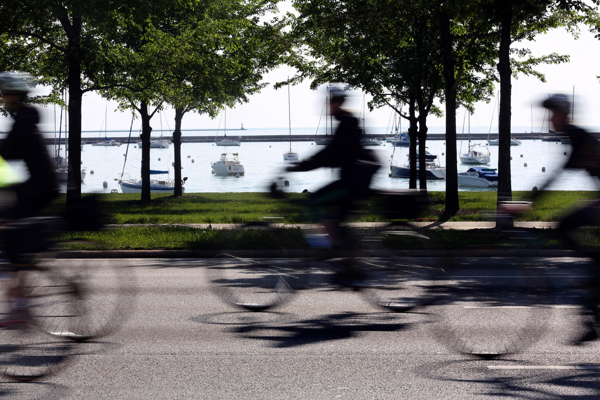 Bicyclists head north on lake Shore Drive with a sparkling Lake Michigan to their right between Jackson and Monroe Avenues. The Active Transportation Alliance proposes a list of 20 locations that it says have strong potential to be transformed into car-free streets and public plazas.