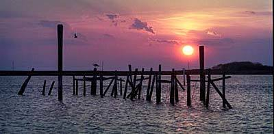 Sunset from the waterfront of Tylerton village on Smith Island, looking west toward the remains of a crab house once used by watermen.