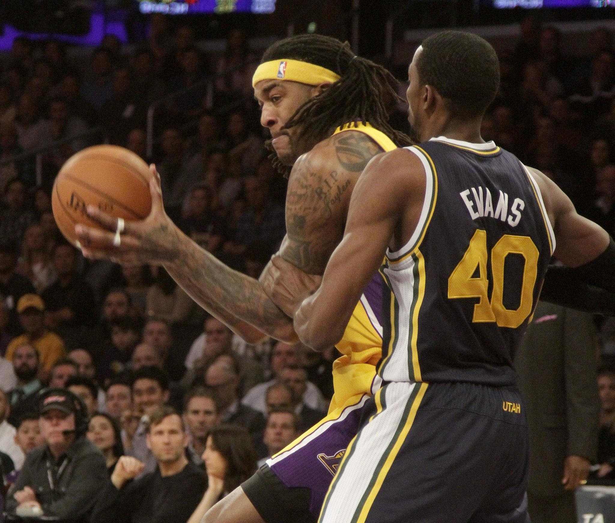 Jordan Hill works against Utah's Jeremy Evans during the Lakers' matchup Tuesday with the Jazz at Staples Center.