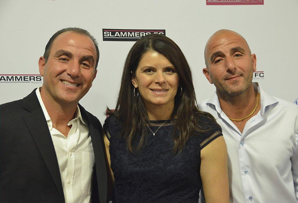 Soccer star Mia Hamm, center, is flanked by Directors of Coaching brothers Walid, left and Ziad Khoury, during the Slammers Celebration at the OC Mix in Costa Mesa.