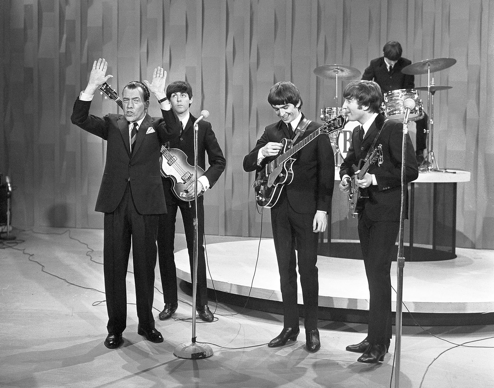 Ed Sullivan (left) introduces the Beatles to America on Feb. 9, 1964, a moment brought back in a 50th anniversary program Sunday at Northampton Community College.