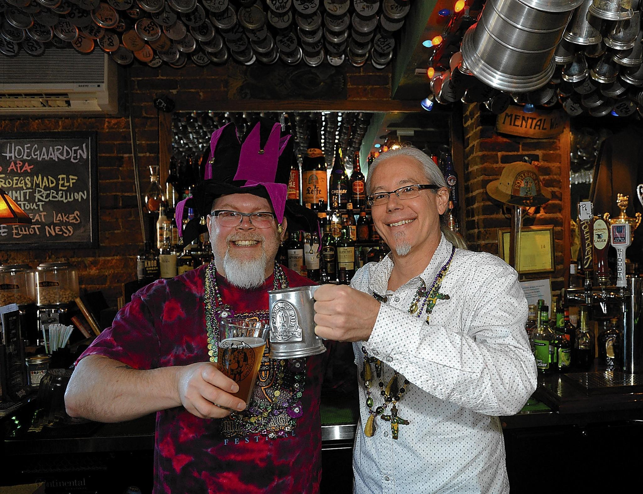 Troy Reynard, co-owner of Two Rivers Brewing Co. iin Easton (left) and Larry Porter co-owner of the bars Porters' Pub and Black & Blue, get ready for Lehigh Valley Beer Week.