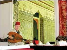 A musician plays at a Tangier eatery.