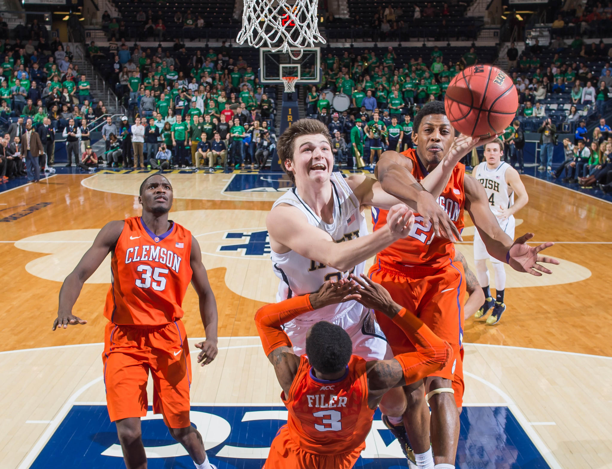 Notre Dame guard Steve Vasturia goes up for a shot as Clemson guard Adonis Filer (3) and guard Damarcus Harrison (21) defend in the first overtime.