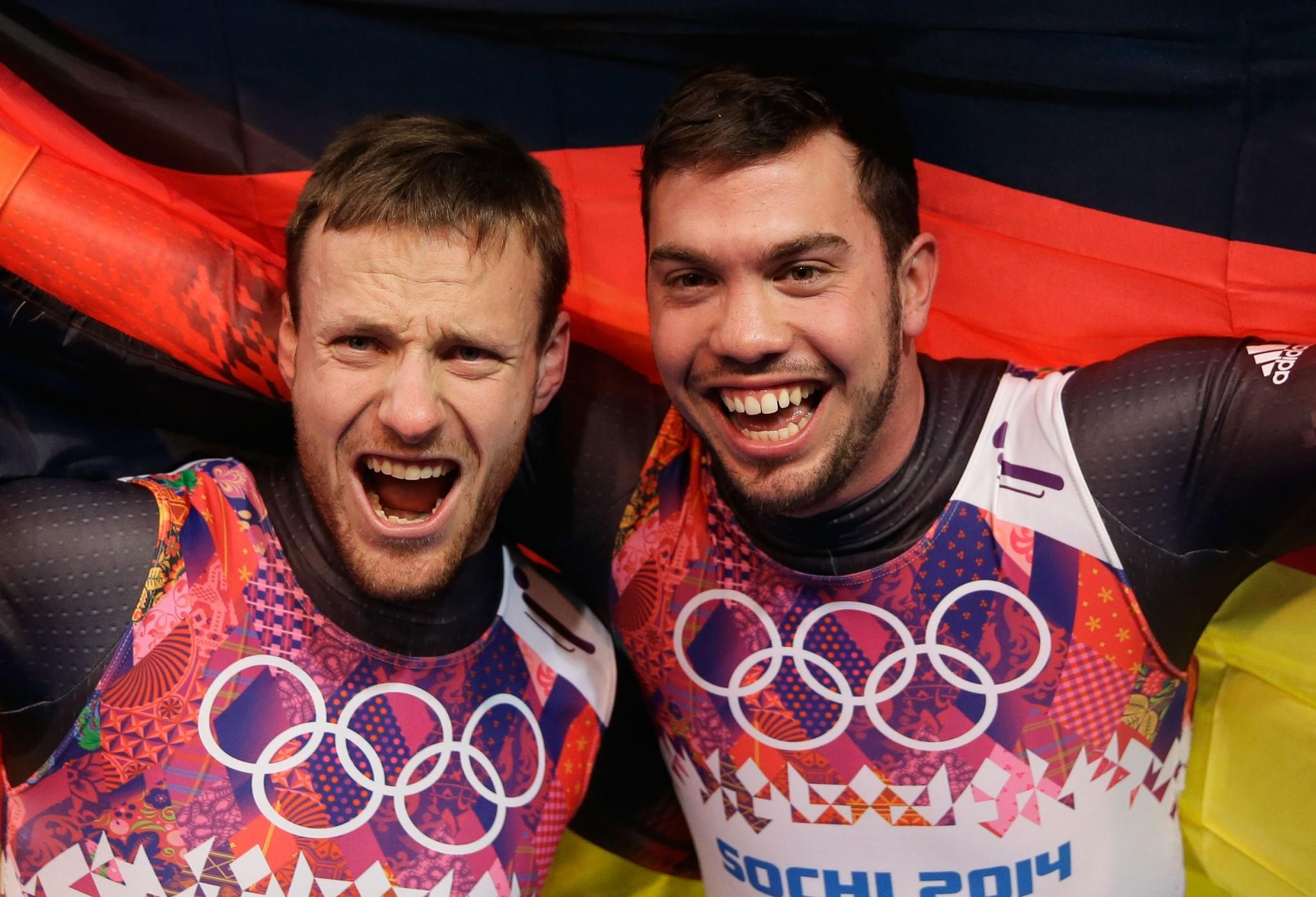 Tobias Wendl (right) and Tobias Arlt of Germany celebrate after winning the gold medal during the Men's Luge Doubles.