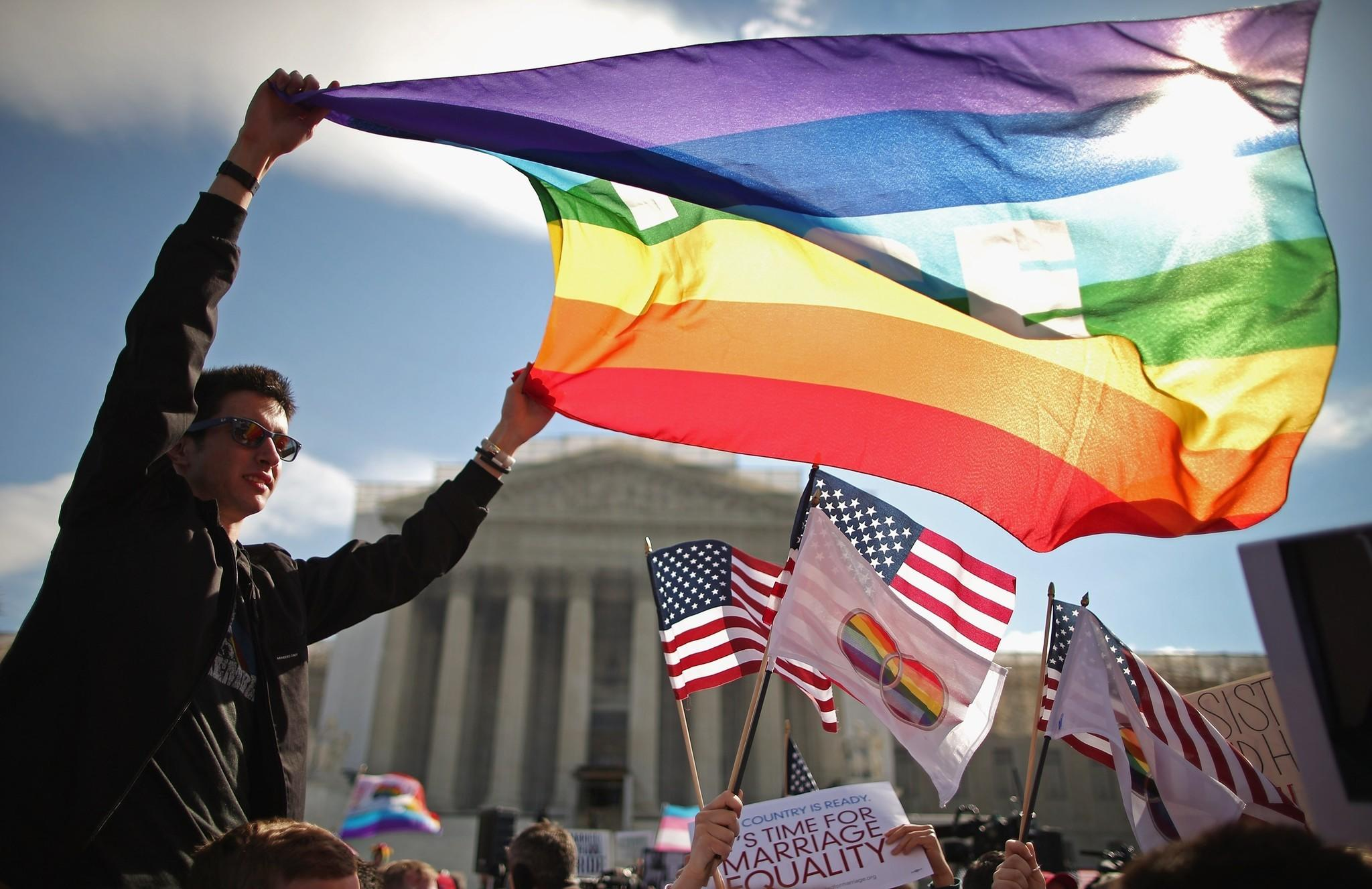 Hundreds rally outside the Supreme Court building in Washington, D.C., during oral arguments in a case challenging the Defense of Marriage Act last March.