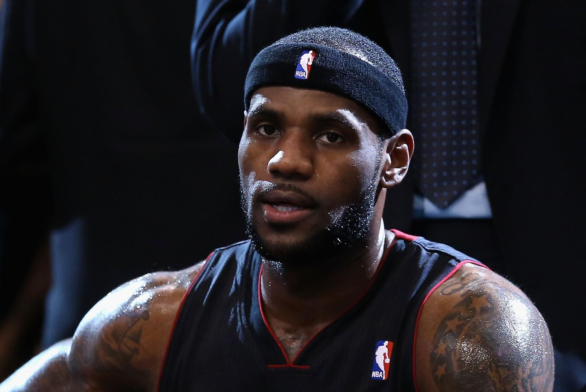 PHOENIX, AZ - FEBRUARY 11: LeBron James #6 of the Miami Heat sits on the bench during a break from the NBA game against the Phoenix Suns at US Airways Center on February 11, 2014 in Phoenix, Arizona. NOTE TO USER: User expressly acknowledges and agrees that, by downloading and or using this photograph, User is consenting to the terms and conditions of the Getty Images License Agreement.