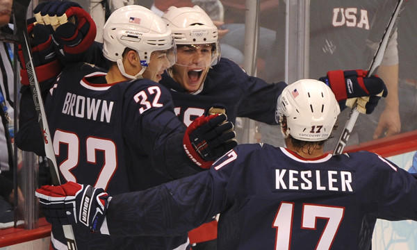 Team USA's Patrick Kane, center, celebrates with teammates Dustin Brown, left, and Ryan Kesler after scoring a goal against Finland at the 2010 Winter Olympic Games in Vancouver, Canada. Team USA hopes its speed will give them the edge in this year's Olympic tournament.